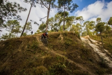 Veteran rider Bimal Gurung, riding a short technical section...